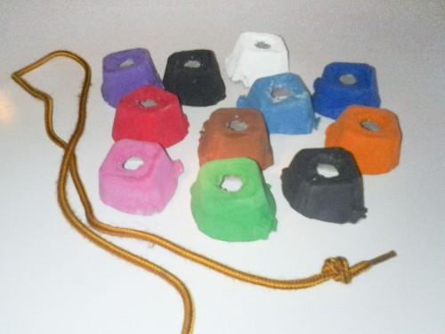 Toddler Activity Idea: Bead painted egg carton pieces onto a shoelace