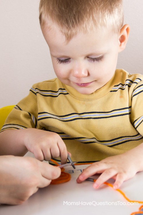Threading the String Shape Lacing Cards - Moms Have Questions Too