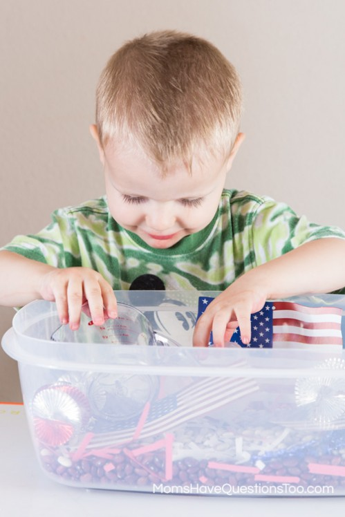 Playing with a 4th of July Sensory Bin - www.momshavequestionstoo.com
