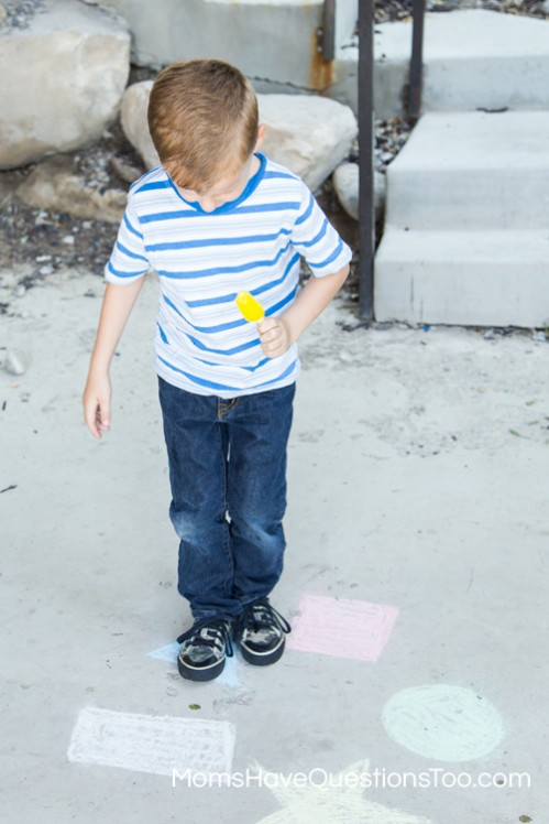 Help improve gross motor skills with a fun game of jumping on chalk shapes and colors - Moms Have Questions Too