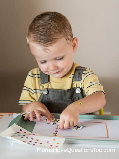 Put Stickers on a square shape for fine motor skills development - Moms Have Questions Too