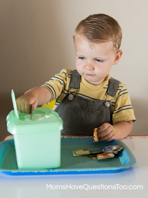 Put cardboard squares in a wipes container for fine motor skills development - Moms Have Questions Too