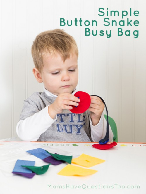 Pushing the shapes on the Button Snake Busy Bag - Moms Have Questions Too