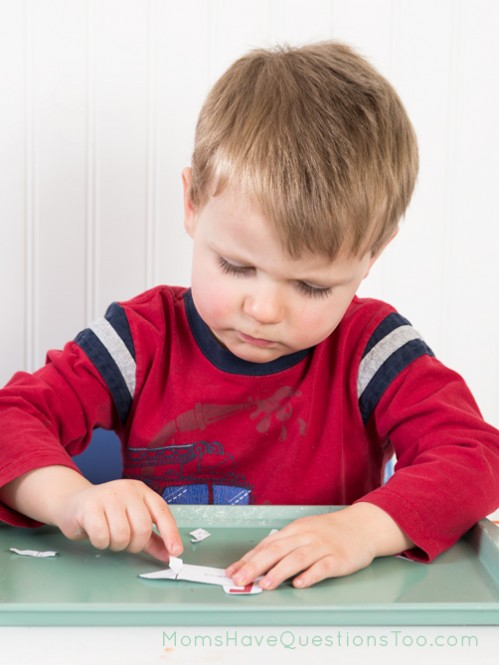 Cutting activity on toddler trays - Moms Have Questions Too