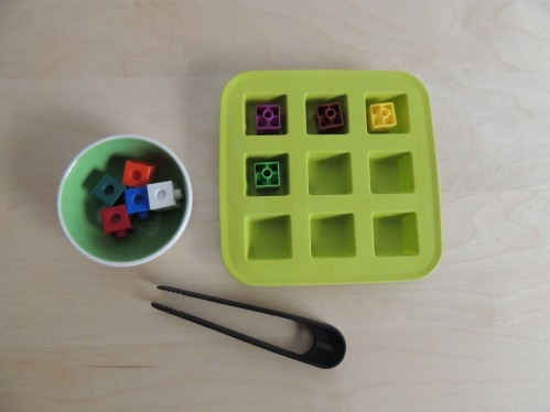 Transfer math cubes into an ice cube tray using tongs