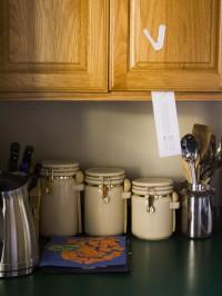 Halloween Skeleton Scavenger Hunt Clue on the Cupboard